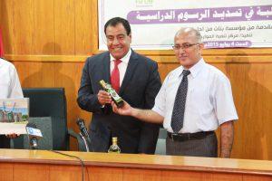 Dr. Al Sarraj presenting Olive Oil to Dr. Abuelaish